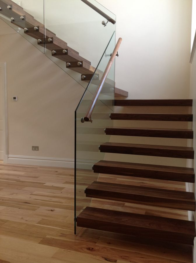 Floating walnut stairs with glass balustrade ajd bespoke Floating stairs