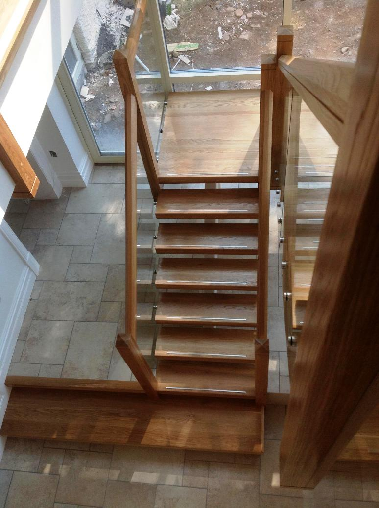 Steel Spine Stairs White Oak With Stainless Steel Inlay